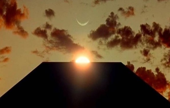 This image is a screen shot from the film 2001 - A Space Odyssey, it shows the Monolith from the film, contrasting light and dark.