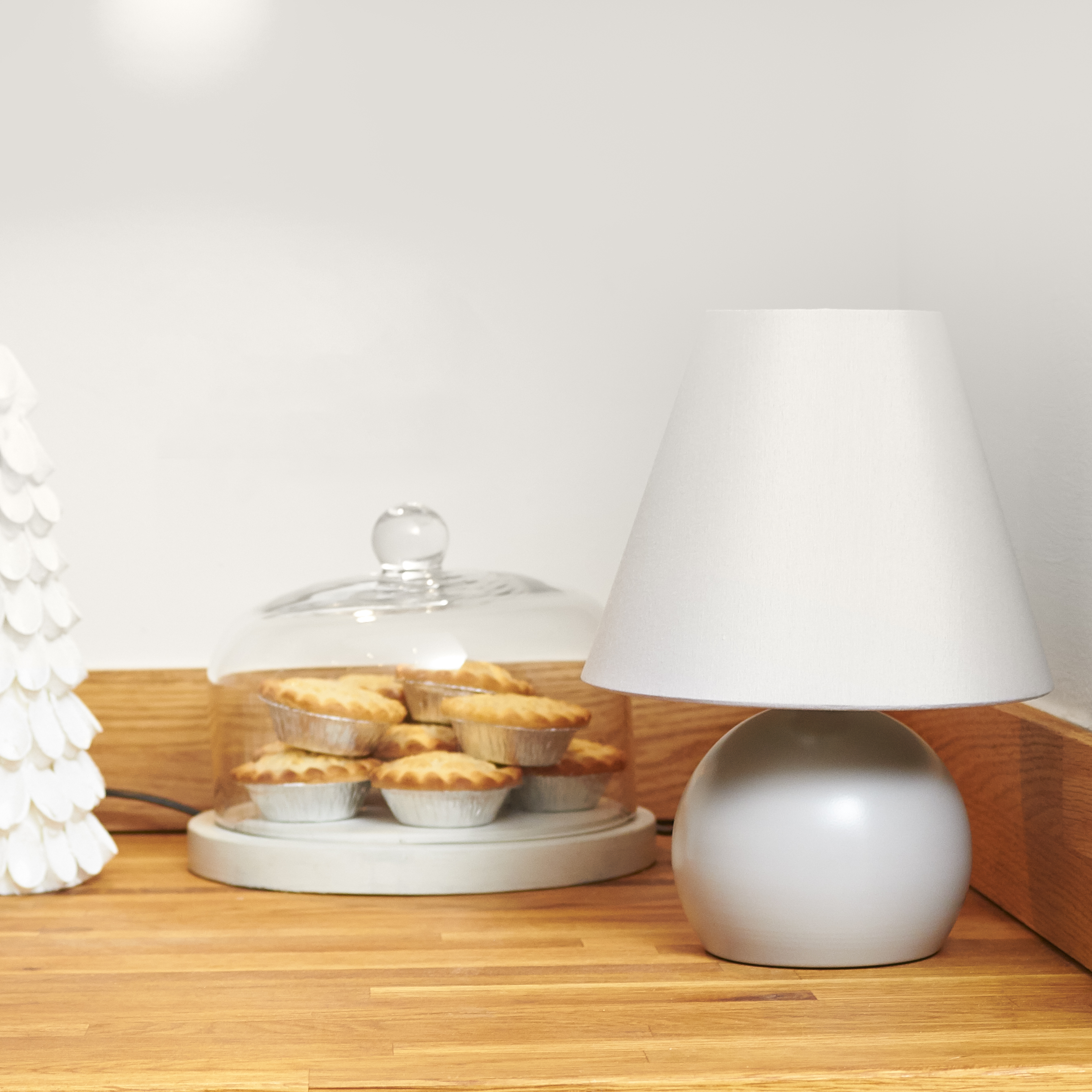 yummy mince pies next to a white ceramic table lamp at xmas
